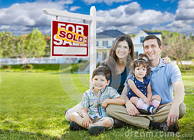 Young Family With Children In Front of Custom Home and Sold For