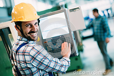 stock image of industrial factory employee working in metal manufacturing industry