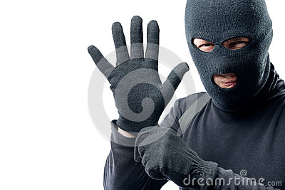 The criminal puts on a glove