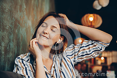 Young woman listen music with headphones and relaxing.