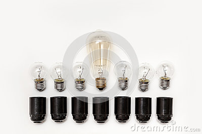 Retro light bulb and electric black cartridges to them on a white background isolated. View from above
