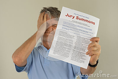 Upset man holding jury duty summons received in the mail