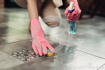 Housework and housekeeping concept. Woman cleaning floor with mo