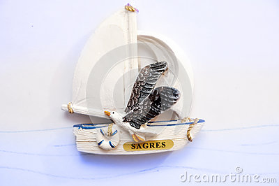 Sagre`s souvenir: sail boat with a seagull. Portugal