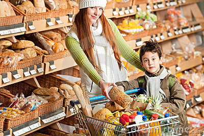 Grocery shopping store - Happy woman with child