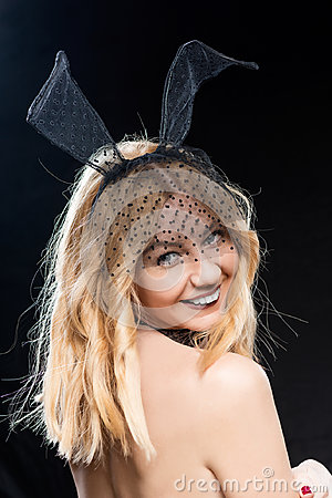 Happy temptress with hare ears on a black