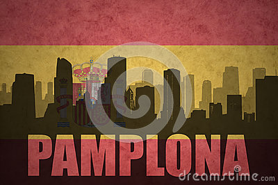 Abstract silhouette of the city with text Pamplona at the vintage spanish flag