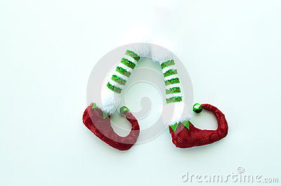 Red and green elf boots isolated on white