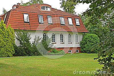 The guest house among coniferous trees. Kaliningrad
