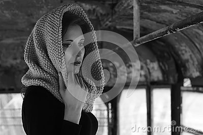 Dramatic portrait of a young beautiful girl. A girl with a pleasant appearance and sad look. Creative portrait of a woman. Attract