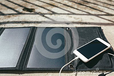 Mobile phone is charging from the solar panel