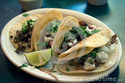 Four tacos on a plate