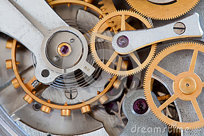 Stopwatch chronometer mechanism cogs gears wheels connection concept. Clock transmission macro view. Shallow depth of