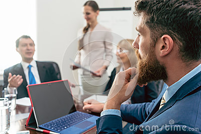 Business consultant listening to the manager of a corporation du