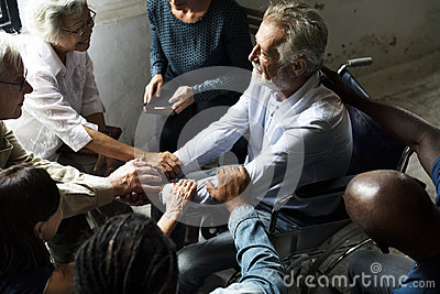 Group of people encouragement to senior man
