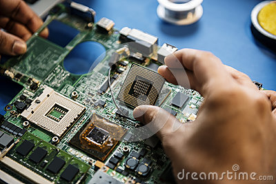 stock image of closeup of hands with computer mainboard microprocessor electronics parts