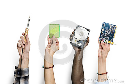stock image of group of hands holding computer electronics parts isolated on white
