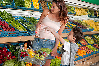 Grocery store - Woman with child buying vegetable