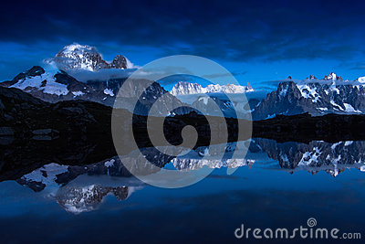 Snow-covered peaks of French Alps mirroring in Cheserys lakes