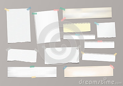 White striped note paper, copybook, notebook sheet stuck with adhesive tape on gray background.