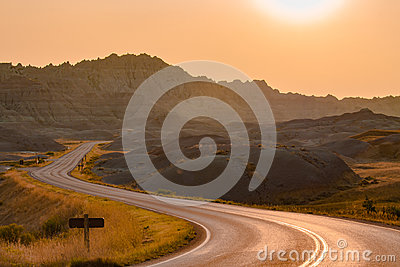 Scenic road at sunset in Badlands National Park.