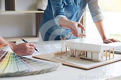 stock image of two young women interior design or graphic designer working on p
