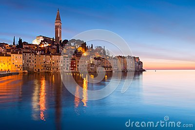 Sunset at medieval town of Rovinj, colorful with houses and church