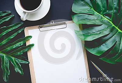 Blank notepaper with tropical leaves and accessories laying on table