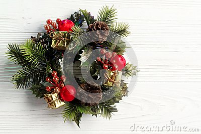 christmas vintage wreath on stylish rustic white wooden background. space for text. holiday greeting card concept. unusual