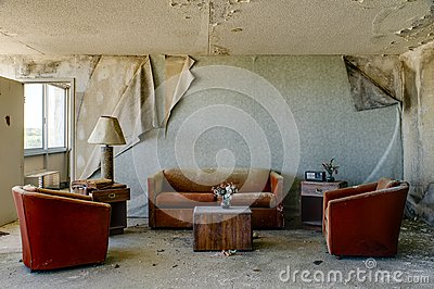 Intact Lodging Room with Burnt Orange Chairs & Couch - Abandoned Hotel