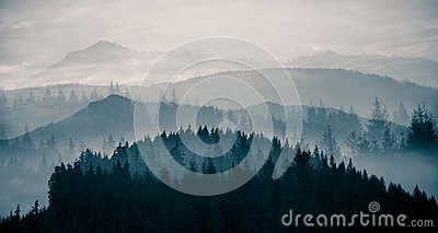 A beautiful, abstract monochrome mountain landscape in blue tonality.