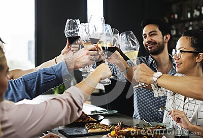 People cheers a wine glasses together