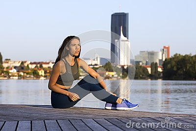 Fitness girl wearing leggings and sneakers