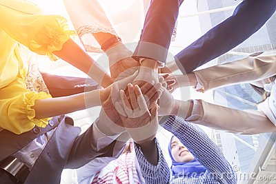 Underneath view of business people hands together and teamwork concept.