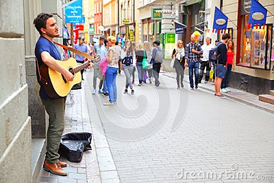 Musician plays guiar in Stockholm