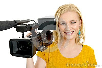 Blond young woman with professional video camcorder, on white