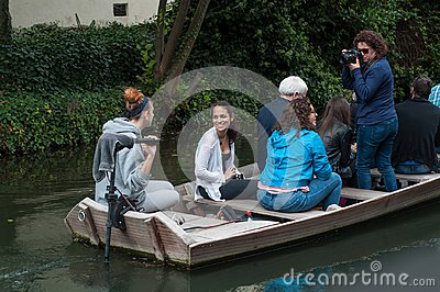 Boat trip tourism on water with smiling people taking photo at little Venise quarter