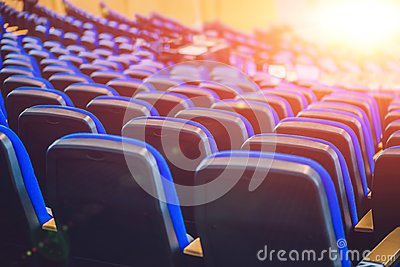 Empty blue chairs at cinema or theater or a conference room