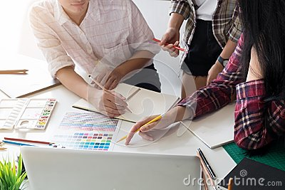 stock image of graphic design team creativity ideas in modern office workplace.