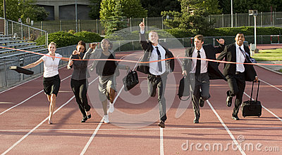Business People Running Across the Finish Line