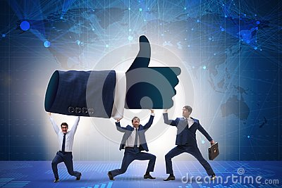 The businessmen supporting thumbs up gesture