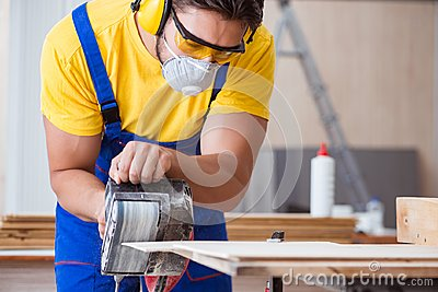 The carpenter working in the workshop