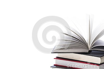 Hardcover books on white background, close up