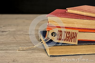 Pile of books and bibliography tag