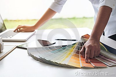stock image of interior design or graphic designer working on project of architecture drawing with work tools and color swatches, colour chart i