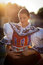 Woman in a richly decorated ceremonial folk dress