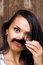 A funny brunette girl with moustache