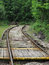 Wooden crossing over railroad tracks