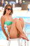 Cute young woman resting near swimming pool