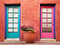 Colorful doors and terracotta wall